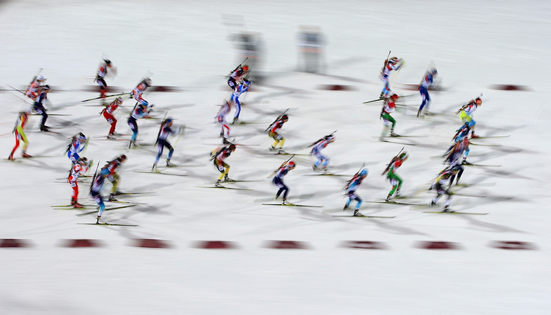 Description of  Athletes compete in the Women's 12.5 km Mass Start during day ten of the Sochi 2014 Winter Olympics at Laura Cross-country Ski & Biathlon Center on February 17, 2014 in Sochi, Russia.  (Photo by Richard Heathcote/Getty Images)
