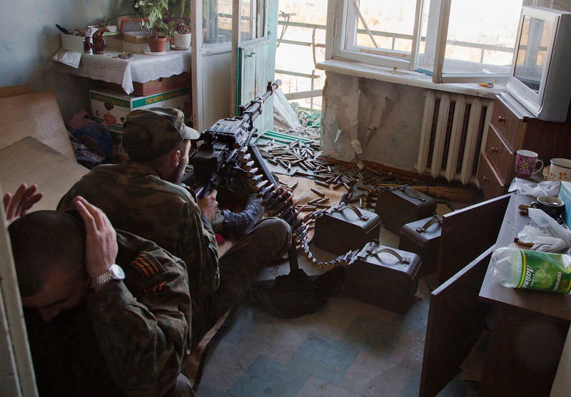 Description of  Pro-Russian rebels fire toward Ukrainian positions near to the airport in the town of Donetsk, eastern Ukraine Tuesday, Oct. 7, 2014.  Despite a cease-fire declared a month ago between the Ukrainian forces and pro-Russian rebels, the biggest city in eastern Ukraine remains embroiled in fighting . (AP Photo/Dmitry Lovetsky)