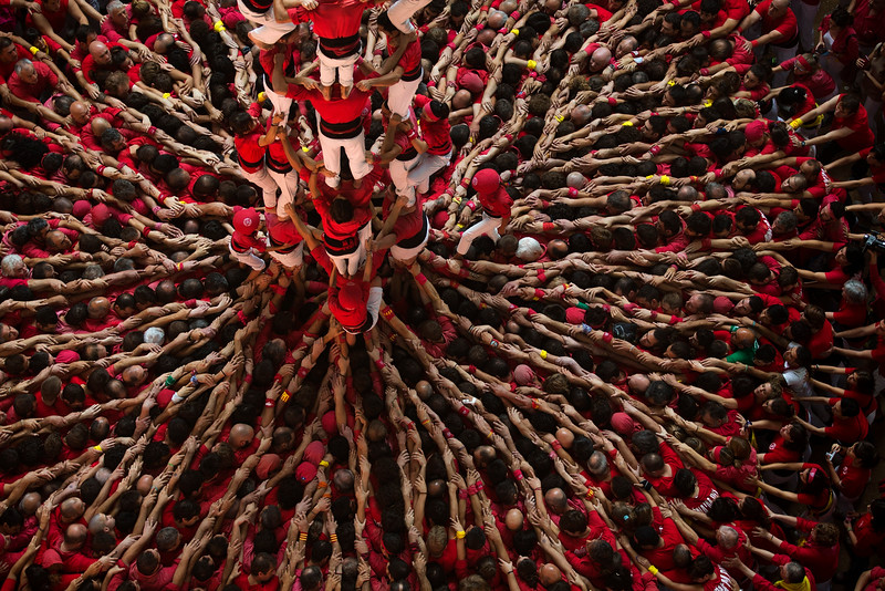 Description of  Members of the Castellers Joves Xiquets de Valls try to complete their human tower during the 25th Human Tower Competition in Tarragona, Spain, on Sunday, Oct. 5, 2014. The tradition of building human towers or ìcastellsî dates back to the 18th century and takes place during festivals in Catalonia, where ìcollesî or teams compete to build the tallest and most complicated towers. The structure of the ìcastellsî varies depending on their complexity. A ìcastellî is considered completely successful when it is loaded and unloaded without falling apart. The highest ìcastellî in history was a 10 floor structure with 3 people in each floor. In 2010 ìcastellsî were declared by UNESCO one of the Masterpieces of the Oral and Intangible Heritage of Humanity. (AP Photo/Emilio Morenatti)