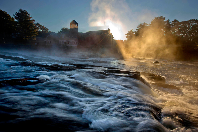 Description of  Steam rises from the Royal River as it flows past the Sparhawk Mill on a chilly autumn morning, Monday, Oct. 6, 2014, in Yarmouth, Maine. (AP Photo/Robert F. Bukaty)