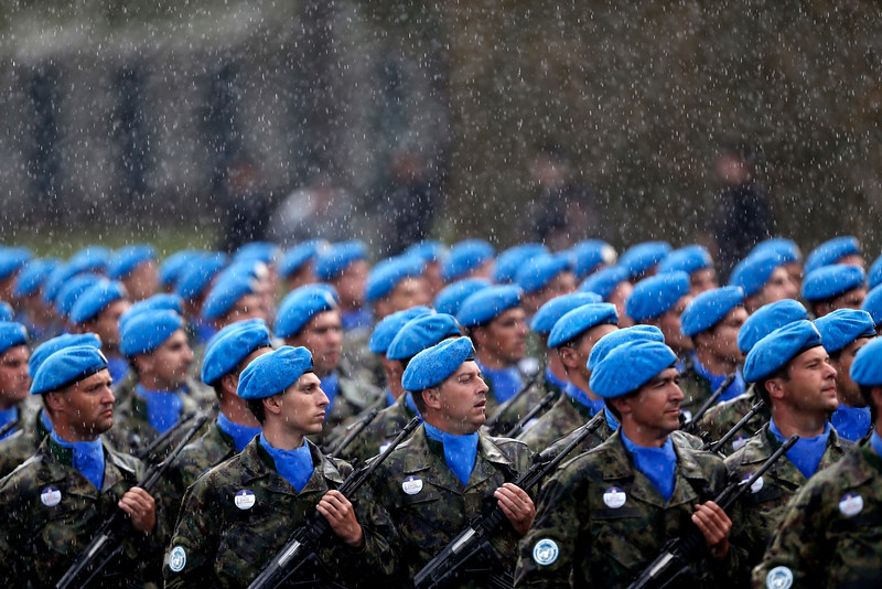 Description of  Members of the Serbian army march under heavy rain during a military parade in Belgrade, Serbia, Thursday, Oct. 16, 2014. Waving Russian and Serbian flags and displaying banners ìThank You Russia,î tens of thousands came to see the parade in Belgrade attended by Vladimir Putin, which marked the 70th anniversary of the liberation of the Serbian capital from the Nazi German occupation by the Red Army and Communist Yugoslav Partisans. (AP Photo/Marko Drobnjakovic)