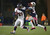 Denver Broncos running back Ronnie Hillman (21) stiff arms New England Patriots cornerback Devin McCourty (32) after along run in the fourth quarter Sunday, September 7, 2012 at Gillette Stadium.  John Leyba, The Denver Post