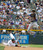 Los Angeles Dodgers shortstop Dee Gordon (9) flies over a sliding Colorado Rockies right fielder Michael Cuddyer (3) to get the force and throw over to first in an attempt to get Colorado Rockies first baseman Todd Helton (17) at first base Sunday, June 3, 2012 at Coors Field.  Helton was safe on the play in the 8th inning. John Leyba, The Denver Post
