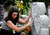 Andrea Sandoval Reed, grieves at her father's headstone at Mt. Olivet Cemetery during burial services. Andrea's father, Paul Sandoval, a former Colorado State Senator, passed away April 24th, 2012 after a battle with pancreatic cancer. Andy Cross, The Denver Post