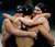 Shannon Vreeland, Dana Volmer and Missy Franklin surround Allison Schmitt as the celebrate their win the women's 4 x 200m freestyle relay during the London 2012 Sumer Games. The team posted an Olympic Record with a time of 7:42.92 to capture the gold medal  John Leyba, The Denver Post