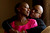Saundra Robinson shares a quiet moment with her husband Marcus Robinson at their home Thursday, March 22, 2012 in Denver. Saundra Robinson survived breast cancer and works in the community to educate others. John Leyba, The Denver Post