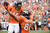 Joel Dreessen celebrates with Brandon Stokley after catching a pass for a Broncos touchdown in the first quarter during the Denver Broncos game against the Oakland Raiders at Sports Authority Field at Mile High on Sunday, September 30, 2012. Joe Amon, The Denver Post