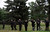 A small crowd of law enforcement officers gather on the lawn of the cemetery as they watch and wave to the long line of law enforcement vehicles entering the cemetery. Funeral services for Denver police officer Celena Hollis took place Saturday, June 30, 2012 at the First Church of the Nazarene followed by a procession to Fairmount Cemetery in Denver. Hollis was shot and killed in the line of duty. Kathryn Scott Osler, The Denver Post