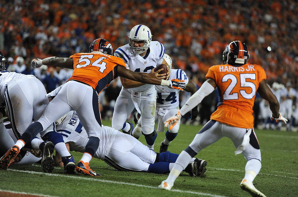 . DENVER, CO - SEPTEMBER 07: Brandon Marshall (54) of the Denver Broncos lays a tackle on Andrew Luck (12) of the Indianapolis Colts to keep him out of the end zone in the third quarter. The Denver Broncos played the Indianapolis Colts at Sports Authority Field at Mile High in Denver, Colo. on September 7, 2014. (Photo by Tim Rasmussen/The Denver Post)