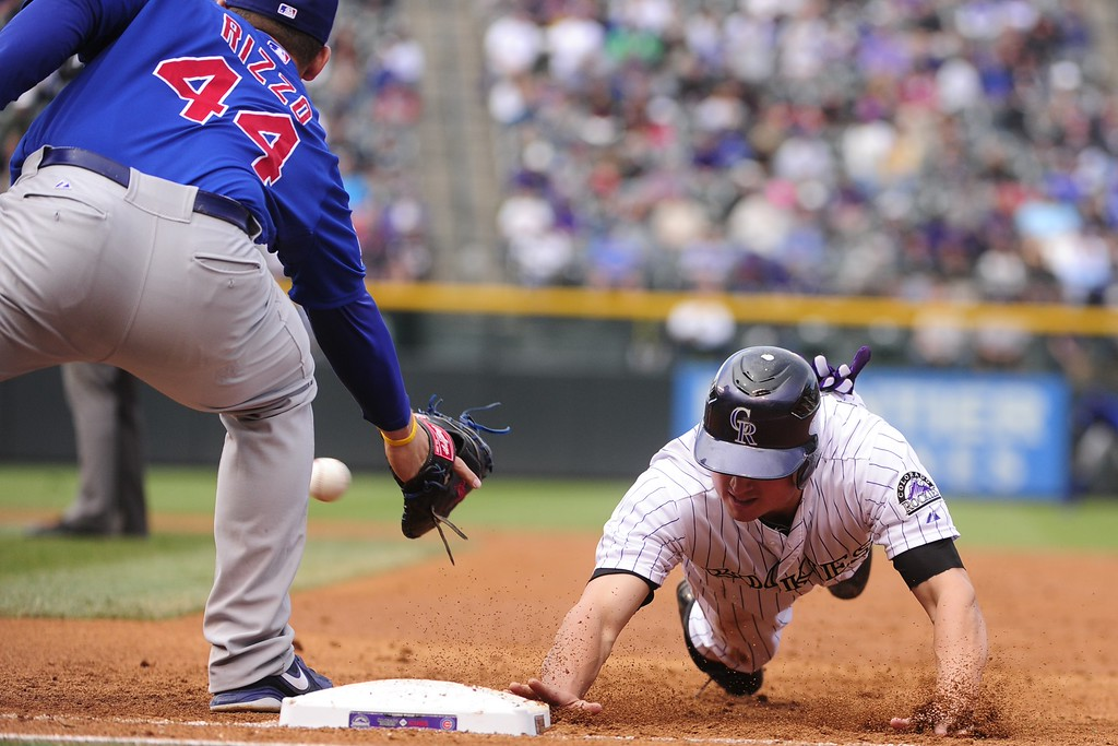 . Colorado Rockies baserunner Jordan Pachaeco dives back to first under the tag of Chicago Cubs first baseman Anthony Rizzo during the Rockies final home game of the season at Coors Field on Thursday, September 27, 2012. AAron Ontiveroz/The Denver Post