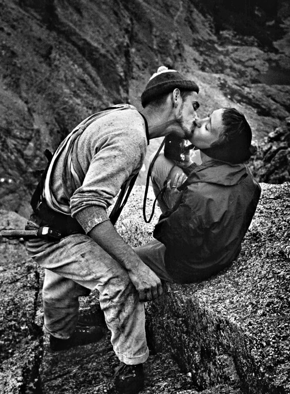 """. JUL 29 1960.  Still wet from icy water that was trickling down chimney at top of cliff, Robert Kamps gets a relieved, proud kiss from his wife, Bonnie. \""""I wasn\'t worried about him,\"""" she said, \""""but I\'m certainly glad to see him.\"""" A climber herself, she was a member of support party for two Alpinists who scaled the forbidding cliff.  (Albert Moldvay/The Denver Post Archive)"""