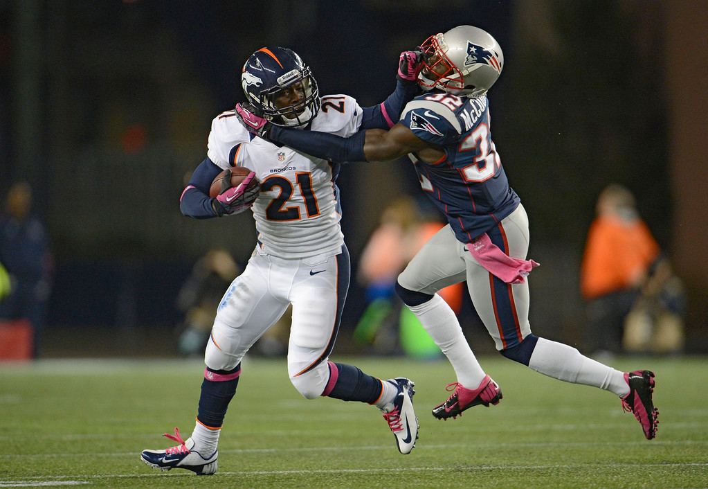 . Denver Broncos running back Ronnie Hillman (21) stiff arms New England Patriots cornerback Devin McCourty (32) after along run in the fourth quarter Sunday, September 7, 2012 at Gillette Stadium.  John Leyba, The Denver Post