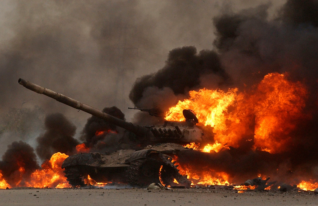 . An Iraqi T72 tank erupts in flames after 2nd Tanks Battalion Bravo Company blew it up on their way to a blocking position near the Tigris River early Wednesday  morning on the outskirts of Saddam City, near the Tigris River. The tank had no personnel but was full of fuel and ammunition. This tank was one of six that were destroyed.    The combat train took fire from an ambush early Wednesday morning from the enemy firing AK-47\'s from both sides of the  narrow road while driving through a small city at about 5:00 a.m Iraq time.  (Photo by Andy Cross/The Denver Post)