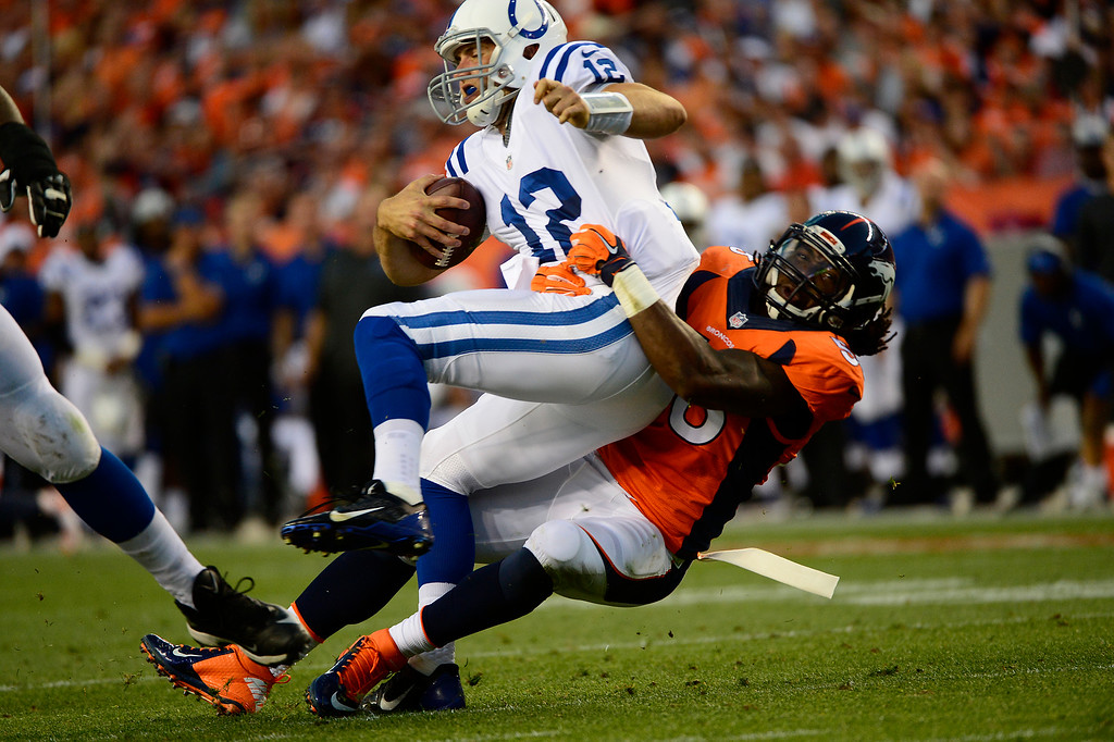 . DENVER, CO - SEPTEMBER 07: Nate Irving (56) of the Denver Broncos charges Andrew Luck (12) of the Indianapolis Colts and sacks him in the second quarter. The Denver Broncos played the Indianapolis Colts at Sports Authority Field at Mile High in Denver, Colo. on September 7, 2014. (Photo by Joe Amon/The Denver Post)