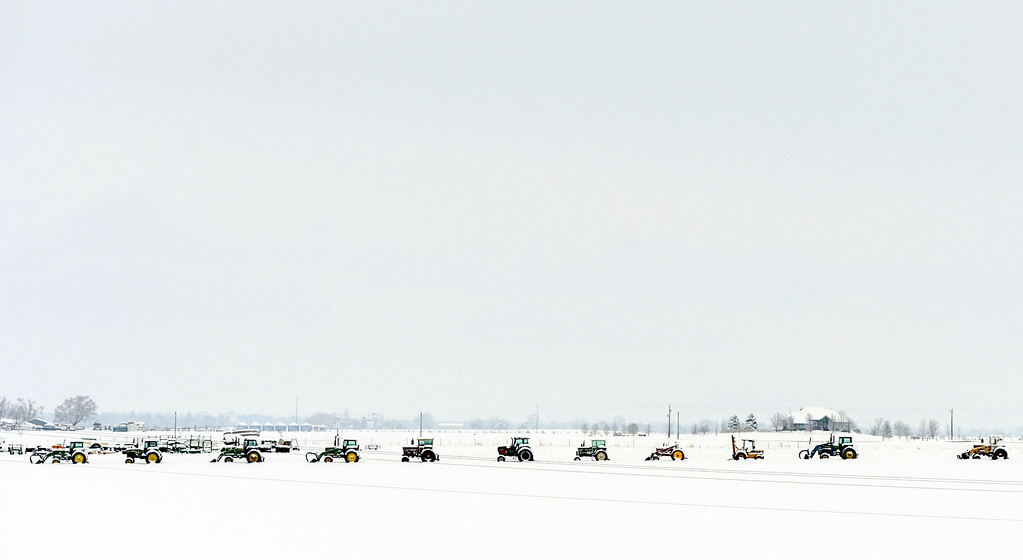 . Farm equipment is lined up in a field near Berthoud, Colorado on April 16, 2013. A spring snow storm hit northern Colorado covering the field in fresh snow. (Photo By RJ Sangosti/The Denver Post)