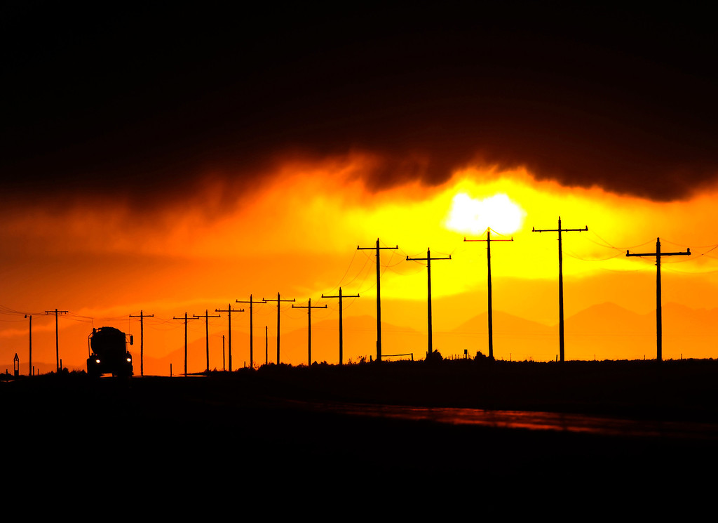 . A trucker made his way down a desolate stretch of road west of Wiggins as the sun set behind the mountains Wednesday night, August 31, 2011.  (Photo by Karl Gehring/ The Denver Post)