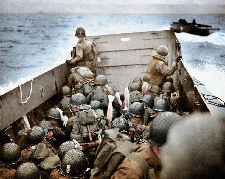Description of  Some of the first American soldiers to attack the German defenses in Higgins Boats (LCVPs) approach Omaha Beach near Normandy, France on June 6, 1944. Plastic covers protect the soldier's weapons against from the water.  (Photo by Robert F. Sargent, U.S. Coast Guard/Galerie Bilderwelt/Getty Images)