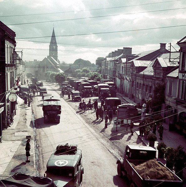 Description of  U. S. Army trucks and jeeps from the invasion against the German troops enter a town in Normandy, France in June of 1944.  (Photo by Galerie Bilderwelt/Getty Images)