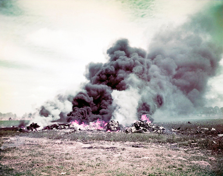 Description of  An Allied plane crash burns during the fighting in Normandy, France in June of 1944.  (Photo by Galerie Bilderwelt/Getty Images)