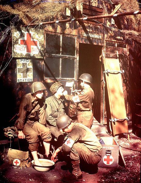 Description of  U.S. Army Medics treating two GIs at a first aid post in southern England in 1944. The soldiers are among the troops due to embark for the invasion of Normandy.  (Photo by Galerie Bilderwelt/Getty Images)