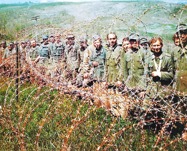 Description of  German Prisoners of War are kept behind barbed wire in Normandy, France in June of 1944. More than 200,000 German soldiers were captured during the Battle of Normandy.  (Photo by Galerie Bilderwelt/Getty Images)