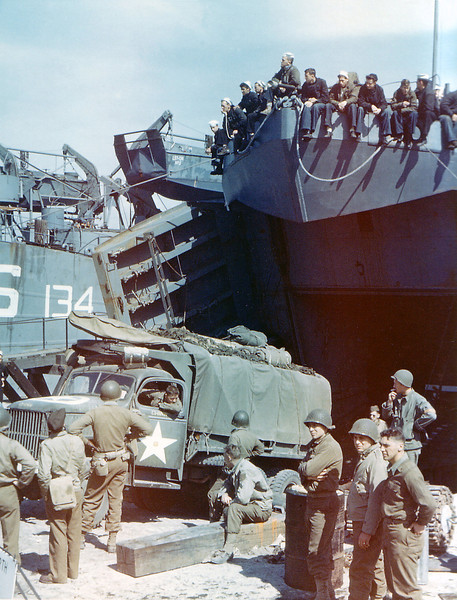 Description of  A truck from the 1st Infantry Division of the United States Army is loaded into the Landing Ship Tank in Dorset, United Kingdom in June of 1944. The LST forms part of Group 30 of the LST Flotilla. The 1st Division was one of the two divisions that stormed Omaha Beach in Normandy, France on D-Day suffering high casualties. (Photo by Galerie Bilderwelt/Getty Images)