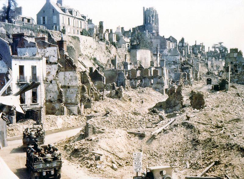 Description of  Two U. S. Army trucks and two American jeeps are driving through the ruins of Saint-Lo in August of 1944. The town was almost totally destroyed by 2,000 Allied bombers when they attacked German troops stationed there during Operation Overlord Normandy in June.  (Photo by Galerie Bilderwelt/Getty Images)