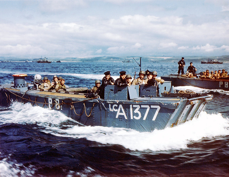 Description of  British Navy Landing Crafts (LCA-1377) carry United States Army Rangers to a ship near Weymouth in Southern England on June 1, 1944. British soldiers can be seen in the conning station. For safety measures, U.S. Rangers remained consigned on board English ships for five days prior to the invasion of Normandy, France.  (Photo by Galerie Bilderwelt/Getty Images)