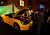 Attendees view a yellow Ferrari SpA California at The Gallery in the MGM Grand Detroit ahead of the 2013 North American International Auto Show (NAIAS) in Detroit, Michigan, U.S., on Saturday, Jan. 12, 2013. The Detroit auto show runs through Jan. 27 and will display over 500 vehicles, representing the most innovative designs in the world. Photographer: Jeff Kowalsky/Bloomberg