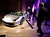 Attendees view the Ferrari SpA 458 Spider at The Gallery in the MGM Grand Detroit ahead of the 2013 North American International Auto Show (NAIAS) in Detroit, Michigan, U.S., on Saturday, Jan. 12, 2013. The Detroit auto show runs through Jan. 27 and will display over 500 vehicles, representing the most innovative designs in the world. Photographer: Jeff Kowalsky/Bloomberg