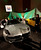 Attendees view a Fisker Automotive Inc. Karma ES at The Gallery in the MGM Grand Detroit ahead of the 2013 North American International Auto Show (NAIAS) in Detroit, Michigan, U.S., on Saturday, Jan. 12, 2013. The Detroit auto show runs through Jan. 27 and will display over 500 vehicles, representing the most innovative designs in the world. Photographer: Jeff Kowalsky/Bloomberg