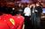 Chef Wolfgang Puck, third right, stands next to a red Ferrari SpA F12 at The Gallery in the MGM Grand Detroit ahead of the 2013 North American International Auto Show (NAIAS) in Detroit, Michigan, U.S., on Saturday, Jan. 12, 2013. The Detroit auto show runs through Jan. 27 and will display over 500 vehicles, representing the most innovative designs in the world. Photographer: Jeff Kowalsky/Bloomberg   *** Local Caption *** Wolfgang Puck