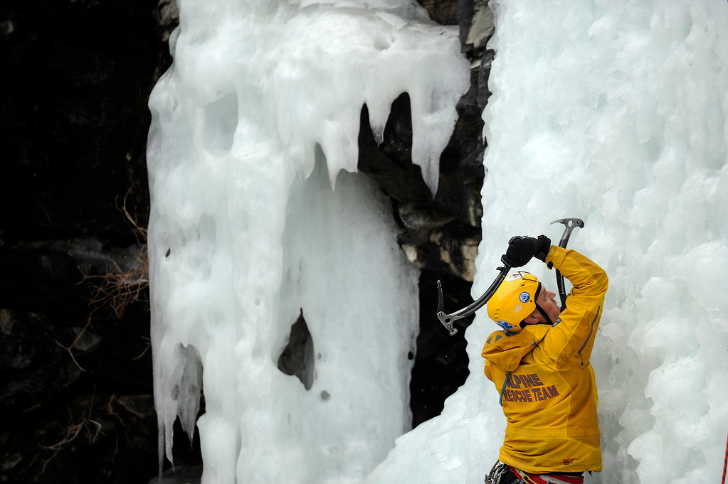 Description of . GOLDEN, CO - FEBRUARY 16: Mark Nelson climbs a frozen water fall during an ice climbing rescue training by the Alpine Rescue Team in Clear Creek Canyon near Golden, Colorado on February 16, 2014. The Alpine Rescue Team is one of a handful of nationally accredited mountain rescue team in Colorado. They specialize in rescue services in hard-to-reach areas and conditions. (Photo by Seth McConnell/The Denver Post)