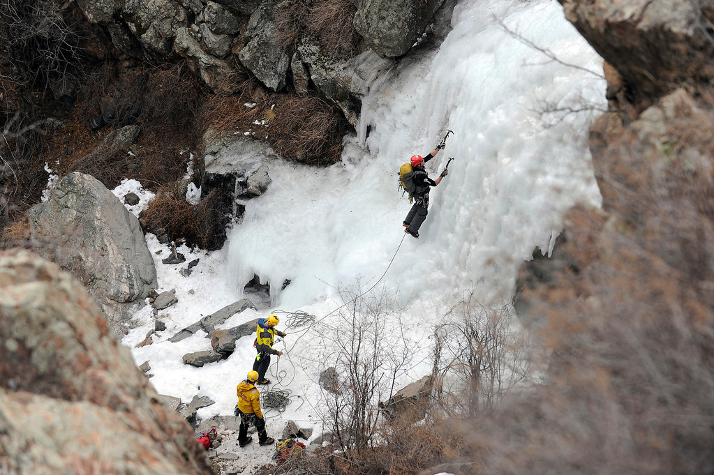 Description of . GOLDEN, CO - FEBRUARY 16: Alpine Rescue Team Field Director Tom Wood climbs a frozen waterfall as he makes his way up to rescue a