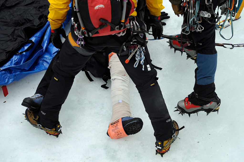 Description of . GOLDEN, CO - FEBRUARY 16: Charlie Adams leg is wrapped with a splint during an ice climbing rescue training by the Alpine Rescue Team in Clear Creek Canyon near Golden, Colorado on February 16, 2014. The Alpine Rescue Team is one of a handful of nationally accredited mountain rescue team in Colorado. They specialize in rescue services in hard-to-reach areas and conditions. (Photo by Seth McConnell/The Denver Post)