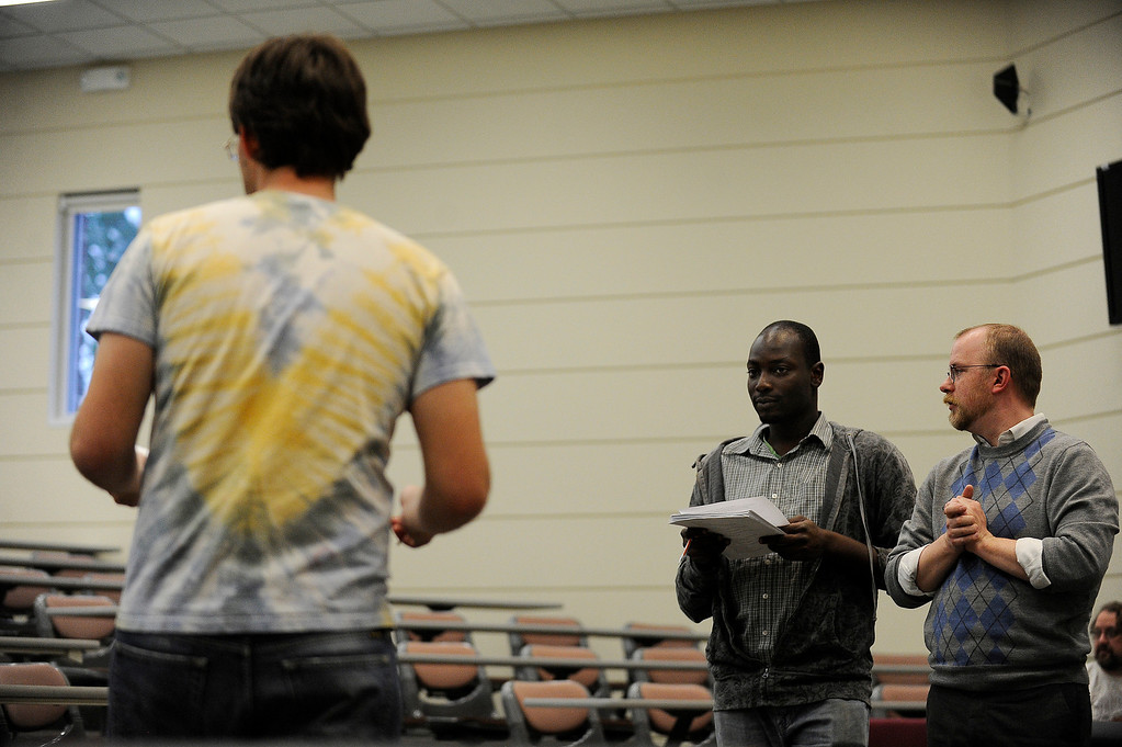Description of . AURORA, CO - APRIL 16: Aaron Spratte, right, and Banji Osindero rehearse a scene from The Music of Change at the Community College of Aurora Fine Arts Building in Aurora, Colorado on April 16, 2014. Aaron Spratte is an Aurora resident who wrote the play The Music of Change about grief and mourning that was presented as a student practicum when he was 18. After a successful kickstarter project that closed last year, Aaron is ready to present his 11-year-old piece at the Aurora Fox for a full month in May. (Photo by Seth McConnell/The Denver Post)