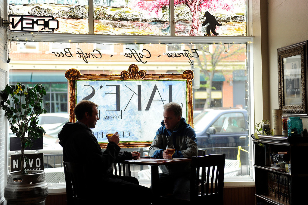 Description of . LITTLETON, CO - MAY 8: Hunter Combs, left, and Jim Zieper chat over beers during happy hour at Jake's Brew Bar in Littleton, Colorado on May 8, 2014. Jake's Brew Bar features a wide selection of beers on tap as well as a full espresso bar. Jake's will soon be expanding to include a beer garden. (Photo by Seth McConnell/The Denver Post)