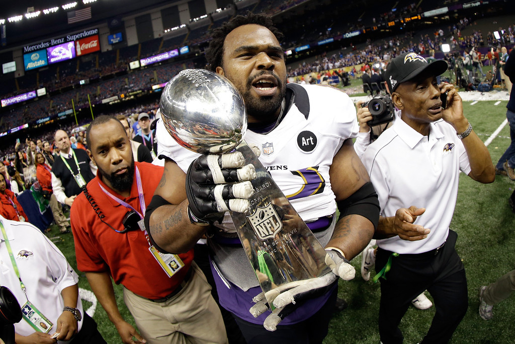 Description of . Bobbie Williams #63 of the Baltimore Ravens holds the Vince Lombardi Trophy after defeating the San Francisco 49ers during Super Bowl XLVII at the Mercedes-Benz Superdome on February 3, 2013 in New Orleans, Louisiana. The Ravens defeated the 49ers 34-31. (Photo by Ezra Shaw/Getty Images)