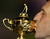In this Sept. 30, 2012 file photo, European team captain Jose Maria Olazabal kisses the trophy after winning the Ryder Cup PGA golf tournament at the Medinah Country Club in Medinah, Ill. (AP Photo/David J. Phillip, File)