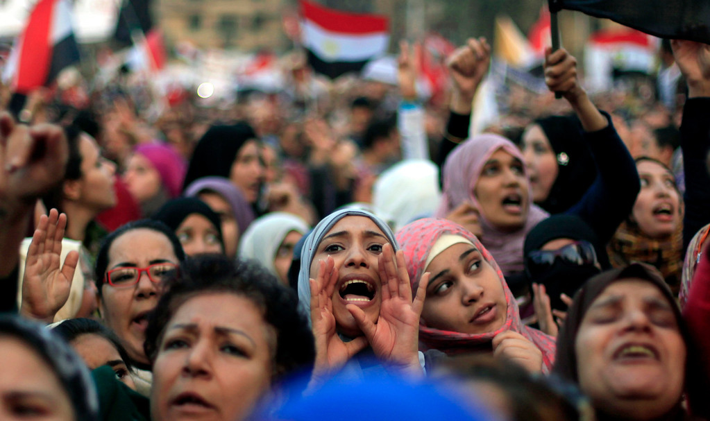 Description of . Egyptian protesters chant slogans against President Mohammed Morsi in Tahrir Square in Cairo, Egypt, Tuesday, Nov. 27, 2012. Egyptians flocked to Cairo's central Tahrir square on Tuesday for a protest against Egypt's president in a significant test of whether the opposition can rally the street behind it in a confrontation aimed at forcing the Islamist leader to rescind decrees that granted him near absolute powers. (AP Photo/ Khalil Hamra)
