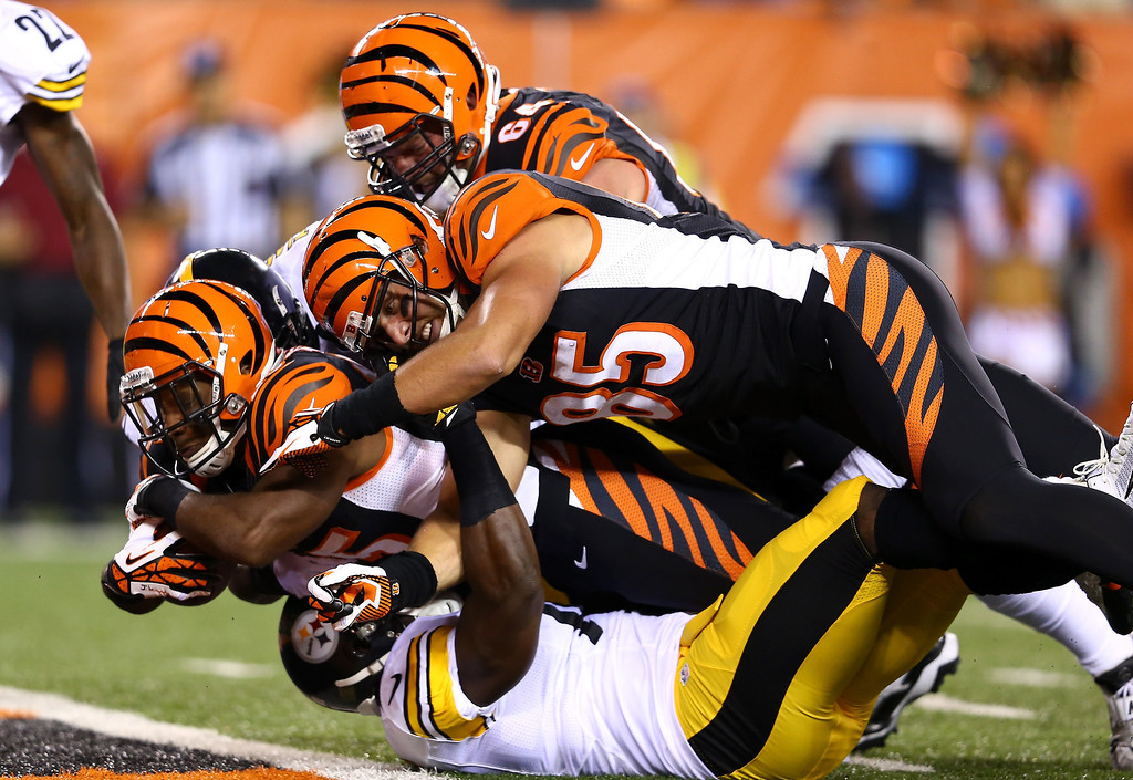 Description of . Running back Giovani Bernard #25 of the Cincinnati Bengals dives into the endzone for a seven-yard touchdown run in the first quarter against the Pittsburgh Steelers in the first half at Paul Brown Stadium on September 16, 2013 in Cincinnati, Ohio.  (Photo by Andy Lyons/Getty Images)