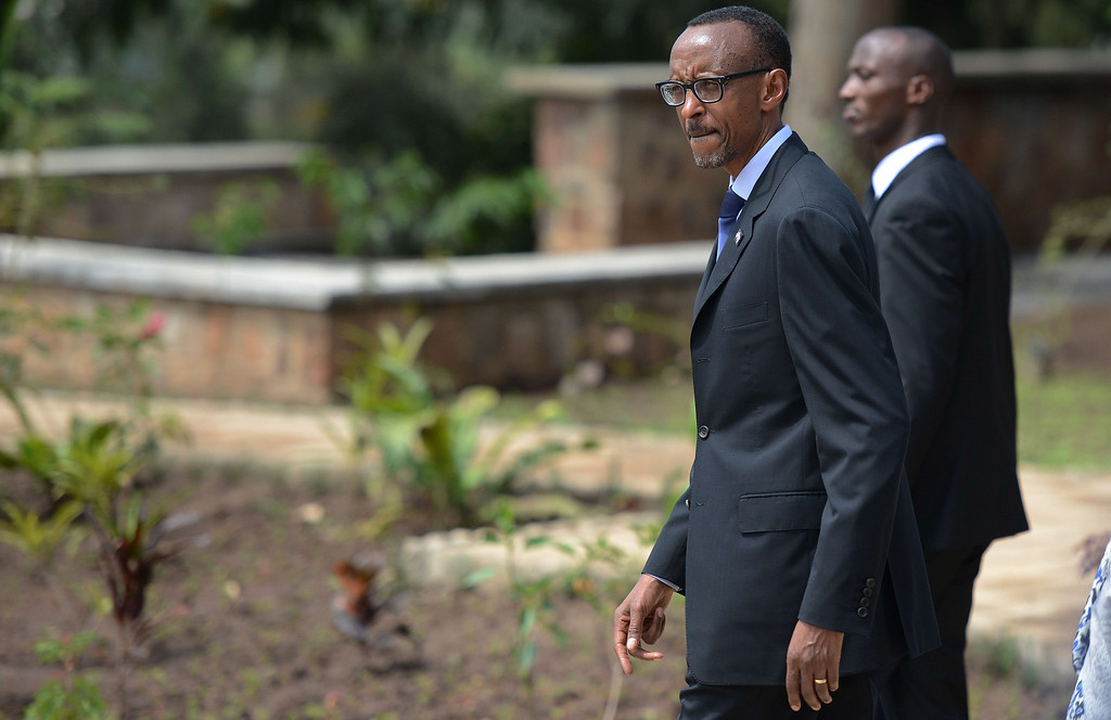 Description of . Rwanda President Paul Kagame arrives to lay a wreath of flowers at the the Gizosi Genocide Memorial in Kigali, on April 7, 2014. AFP PHOTO / SIMON MAINA/AFP/Getty Images