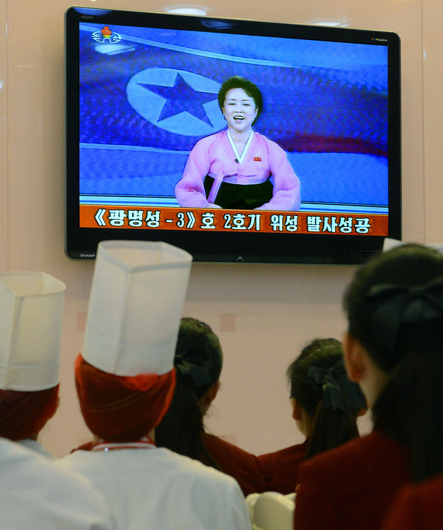 . North Korean employees at a restaurant watch TV broadcast in Pyongyang, North Korea Wednesday noon, Dec. 12, 2012. North Koreaís state broadcaster has announced on TV that Pyongyangís rocket launch was a success. (AP Photo/Kyodo News)