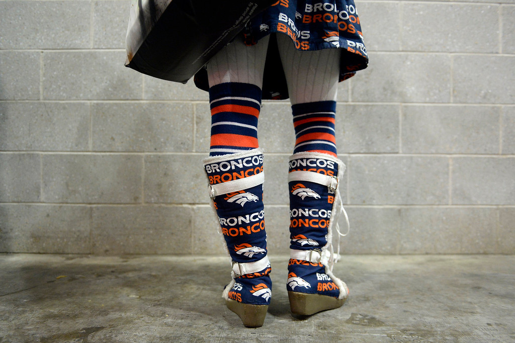 Description of . Kristina Graham of Highlands Ranch, Colorado sports Broncos gear prior to the game.  The Denver Broncos vs the Seattle Seahawks in Super Bowl XLVIII at MetLife Stadium in East Rutherford, New Jersey Sunday, February 2, 2014. (Photo by AAron Ontiveroz/The Denver Post)