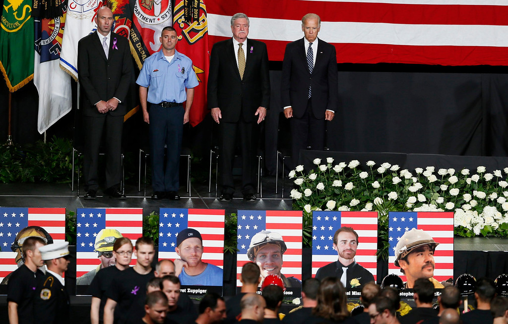 Description of . Vice President Joe Biden (R) watches as firefighters file in at a memorial service for the fallen members of the Granite Mountain Hotshots, in Prescott Valley, Arizona July 9, 2013. REUTERS/Lucy Nicholson