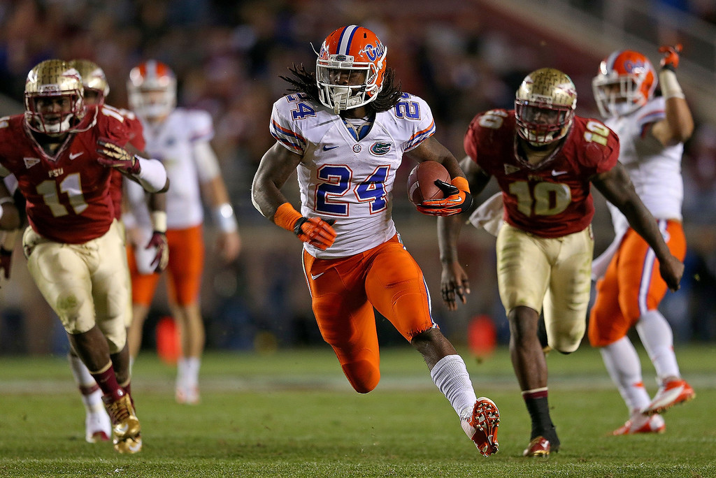 Description of . Matt Jones #24 of the Florida Gators rushes for a touchdown during a game against the Florida State Seminoles at Doak Campbell Stadium on November 24, 2012 in Tallahassee, Florida.  (Photo by Mike Ehrmann/Getty Images)