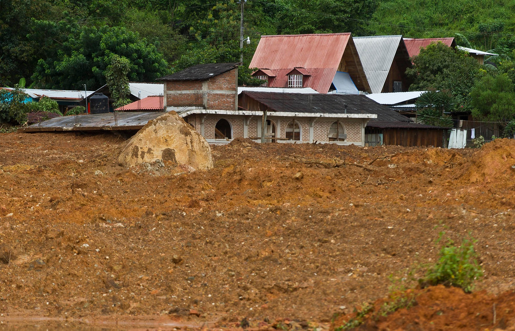 Description of . The remains of a buried house can be seen after a landslide in La Pintada, state of Guerrero, Mexico, on September 19, 2013 as heavy rains hit the country.   AFP PHOTO/RONALDO  Schemidt/AFP/Getty Images