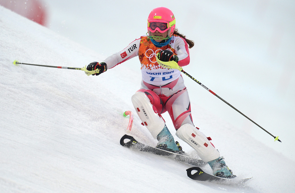 Description of . Tugba Kocaaga of Turkey in action during the first run of the Women's Slalom race at the Rosa Khutor Alpine Center during the Sochi 2014 Olympic Games, Krasnaya Polyana, Russia, 21 February 2014.  EPA/VASSIL DONEV