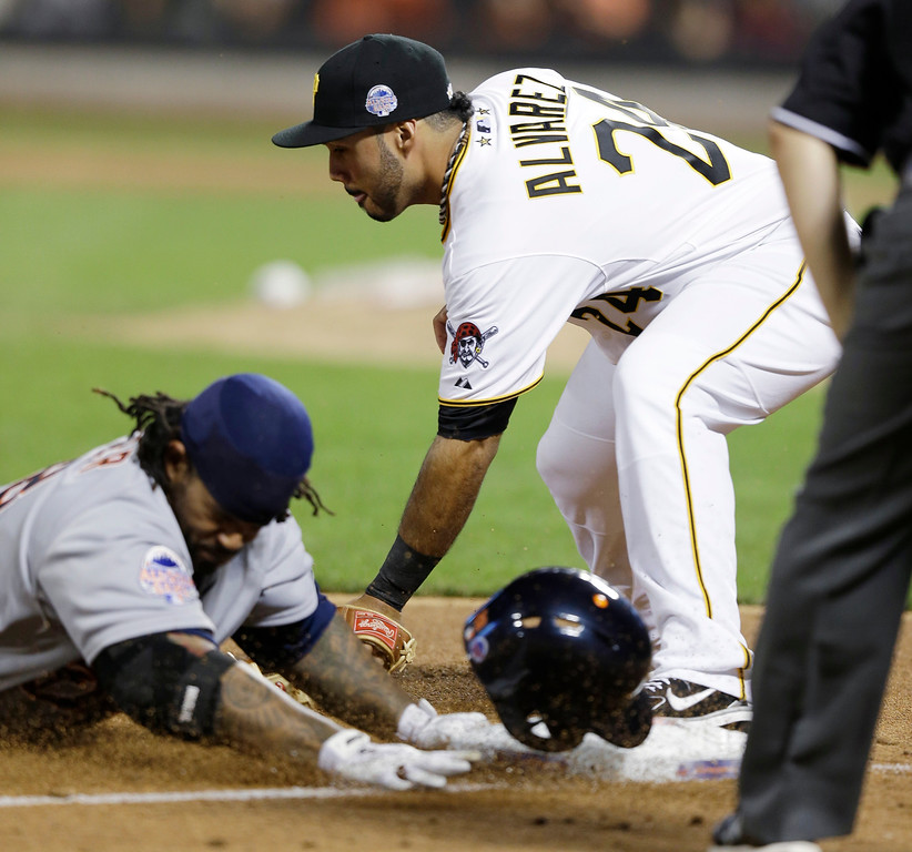 Description of . American League�s Prince Fielder, of the Detroit Tigers, is safe at third as National League�s Pedro Alvarez, of the Pittsburgh Pirates, attempts to make the tag on a triple by Fielder during the ninth inning of the MLB All-Star baseball game, on Tuesday, July 16, 2013, in New York. (AP Photo/Kathy Willens)