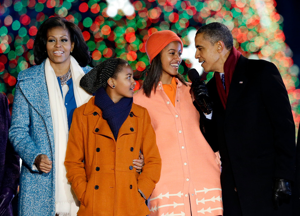 Description of . President Barack Obama, right, first lady Michelle Obama, left, Sasha Obama, second from left, and Malia Obama, sing during the 90th annual National Christmas Tree Lighting ceremony on the Ellipse south of the White House, Thursday, Dec. 6, 2012, in Washington. (AP Photo/Alex Brandon)